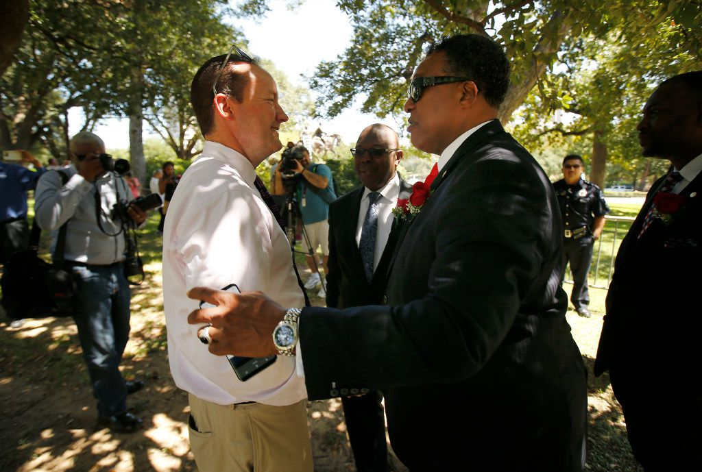 Dallas Councilman Philip Kingston (left) shakes hands with Dwaine Caraway as they came to see the removal of the Robert E. Lee statue from Robert E. Lee Park in Dallas, Wednesday, September 6, 2017. Earlier in the day the Dallas City Council voted 13-1 for immediate removal of the monument to the Confederate general with a soldier at his side. The removal was halted though by a temporary restraining order from U.S. District Judge Sidney A. Fitzwater. (Tom Fox/The Dallas Morning News)