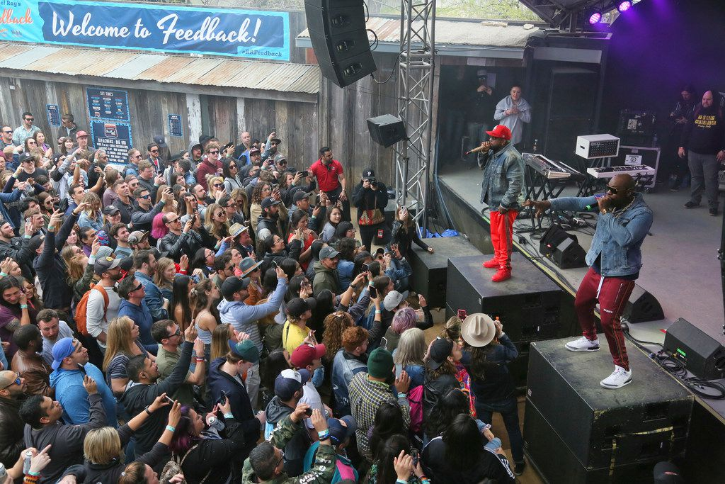 Big Boi, upper right, and Sleepy Brown perform at Rachael Ray's Feedback Party at Stubb's during the South by Southwest Music Festival on Saturday, March 16 2019, in Austin, Texas.