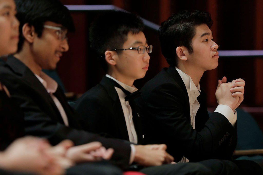 Competitors wait for the Quarterfinalist announcement of the Cliburn International Junior Piano Competition and Festival at Caruth Auditorium on the SMU Campus in Dallas.
