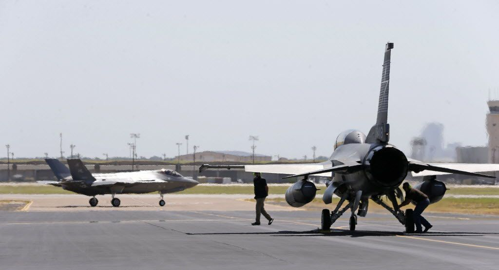 Crew members prepare a F-16 to escort an Air Force version of the F-35 for a test flight at Lockheed Martin Aeronautics in Fort Worth.
