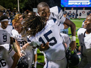 Frisco Lone Star safety Toren Pittman (15) lifts up wide receiver Marvin Mims (18) as they celebrate with teammates after a victory over Highland Park in a high school football game at Highlander Stadium on Friday, Sept. 13, 2019, in Dallas. (Smiley N. Pool/The Dallas Morning News)