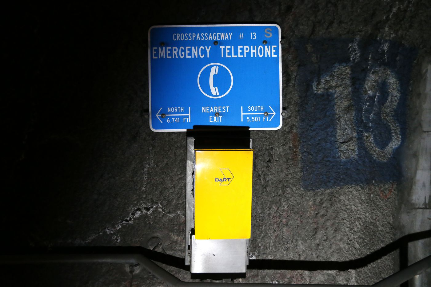 An emergency phone and directions to the nearest exit, seen inside DART's underground tunnel system in Dallas, Friday, July 20, 2018.