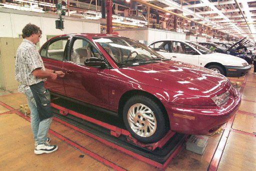 ORG XMIT: NS101 Tom Evans checks the door locks on the front end assembly line at the General Motors Saturn plant in Spring Hill, Tenn. on Monday, July 13, 1998. Saturn Corporation's workers are set to hold their first-ever strike authorization vote on Sunday, July 19, 1998.  The United Auto Workers local could call a strike as early as next Friday if two-thirds of the 7,200 members authorize a walkout against Saturn, the General Motors division whose advertising depicts employees cheerfully working together in teams for an uncommonly humane corporation. (AP Photo/Mark Humphrey)