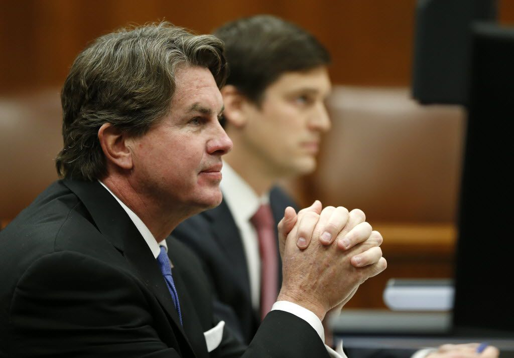 Plaintiff Jeffory Blackard (left) and his attorney Austin Champion listened to Judge Mark Greenberg during a hearing over his request for a temporary restraining order to stop payment of the $252,000 bill to the Paxton special prosecutors at George Allen Courts Building in Dallas last January. (File 2016/The Dallas Morning News)