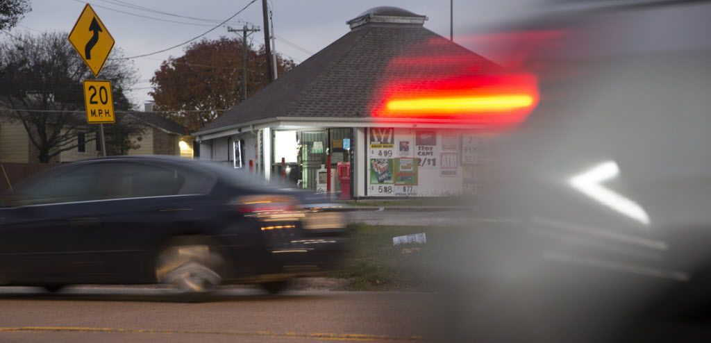 Vehicles drive past J's Food Mart at 10041 Whitehurst Drive in the Lake Highlands area.
