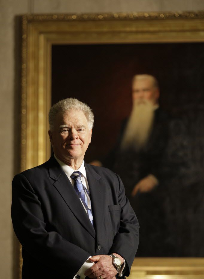 Portrait of Seminary President Paige Patterson poses alongside an oil portrait of B.H. Carroll, the Southwestern Baptist Theological Seminary's first president.
