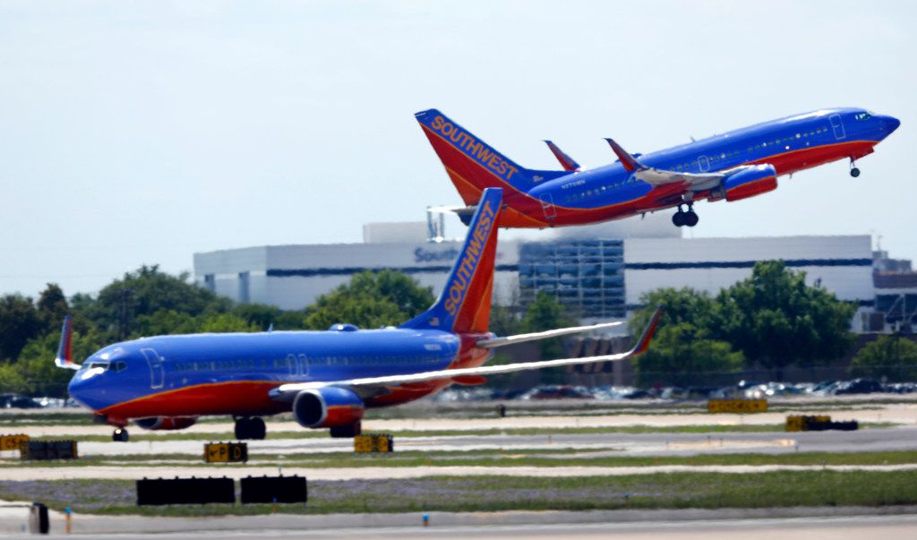 A Southwest Airlines jet takes off in front of company headquarters at Dallas Love Field.