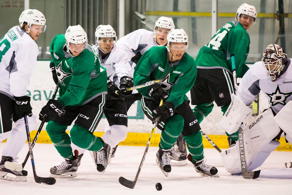 (From left to right) defenseman Niklas Hansson (38), defenseman Michael Prapavessis (51), defenseman Miro Heiskanen (33), forward Shaw Boomhower (57), defenseman Shane Hanna (39) and forward Carson Gicewicz (54) fight for possesion of the puck in font of goalie Colton Point on the first day of Dallas Stars development camp at the Dr Pepper StarCenter on Saturday, July 8, 2017, in Frisco. (Smiley N. Pool/The Dallas Morning News)