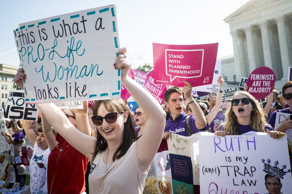 Pro-choice and pro-life activists demonstrate on the steps of the United States Supreme Court on June 27, in Washington, DC.