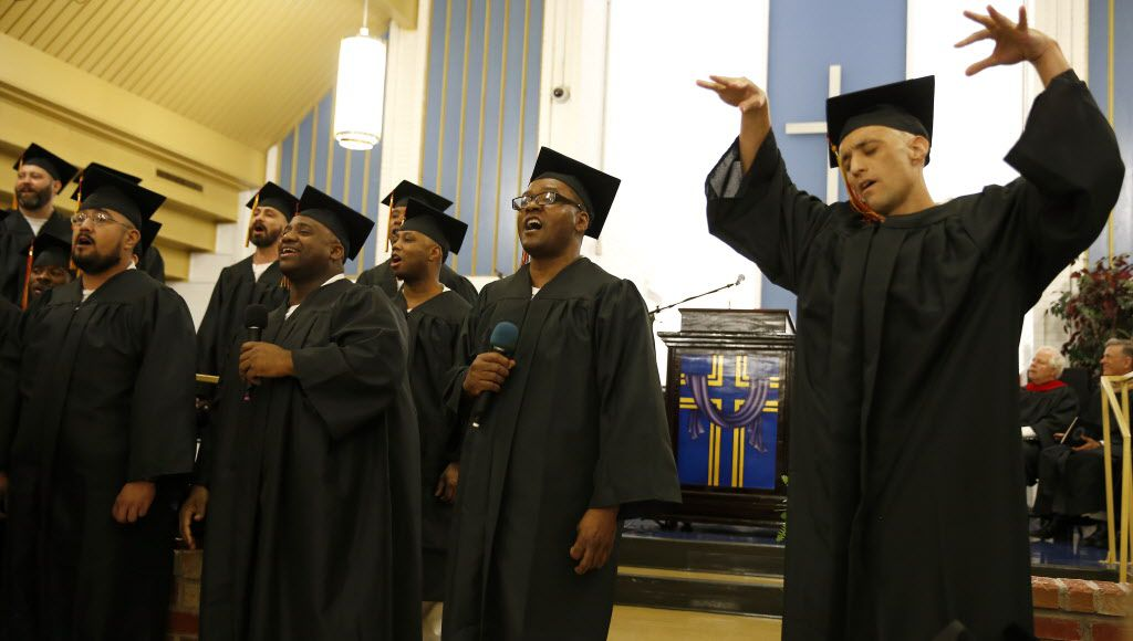 Inmates including Scott Copeland (right) sing gospel music during the commencement of Southwestern Baptist Theological Seminary at the Darrington Unit. (Jae S. Lee/Staff Photographer)