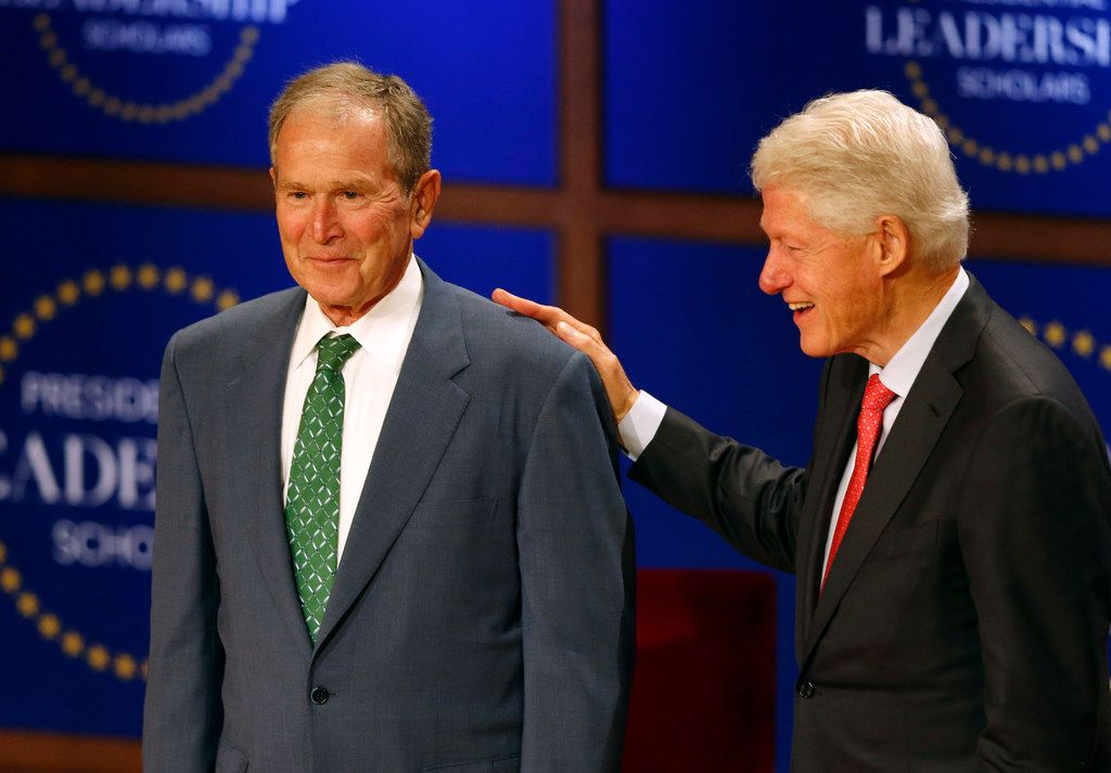 Former President George W. Bush and former President Bill Clinton share a laugh as they prepared to shake hands with the 2019 Presidential Leadership Scholars during Thursday's graduation ceremony at the George W. Bush Presidential Center. This is the fifth anniversary since the program began in 2015.