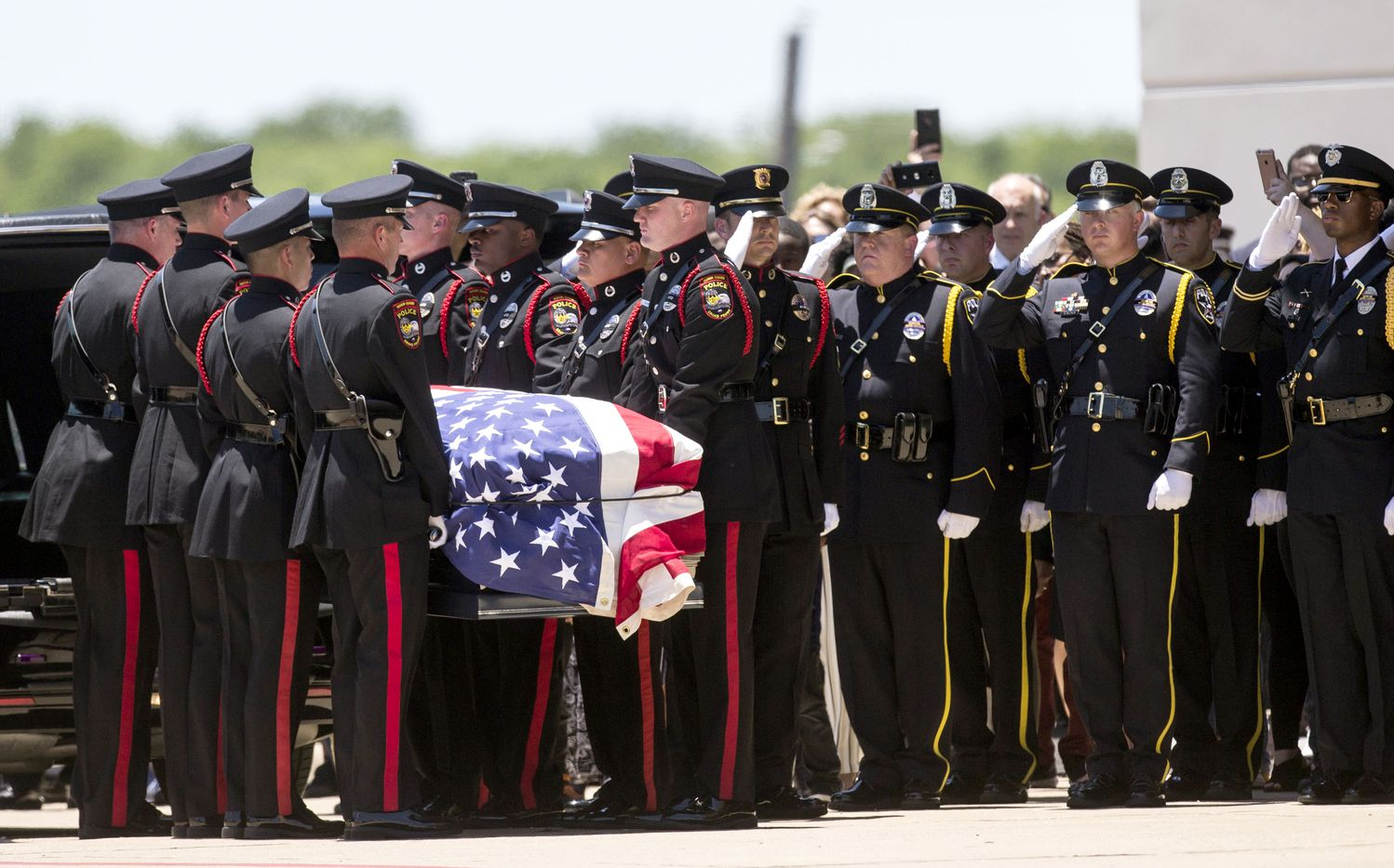 Honor guard members carry the casket Grand Prairie Officer A.J. Castaneda during funeral services at The Potter's House on Thursday, June 13, 2019 in Dallas. Castaneda was killed June 7 while on the George Bush Turnpike.