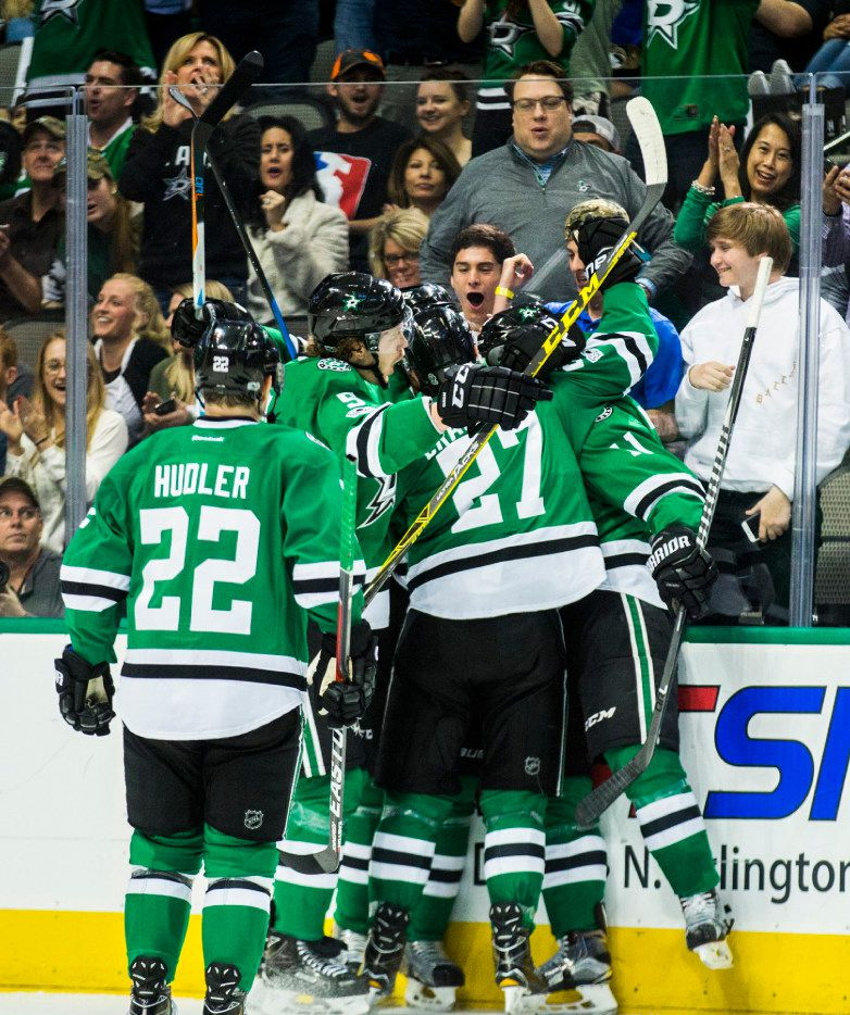 Dallas Stars celebrate a goal scored by left wing Curtis McKenzie (11) during the second period against the San Jose Sharks on Monday, March 20, 2017 at the American Airlines Center in Dallas, Texas. (Ashley Landis/Dallas Morning News/TNS)  NO MAGAZINE SALES MANDATORY CREDIT; NO SALES; INTERNET USE BY TNS CONTRIBUTORS ONLY