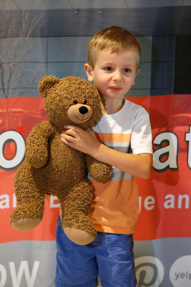 """Luke Swofford, 4, poses for a photograph with his teddy bear named """"Teddy Bear"""" after he picks him up at the lost and found at Dallas Love Field Airport in Dallas, Wednesday, July 26, 2017."""
