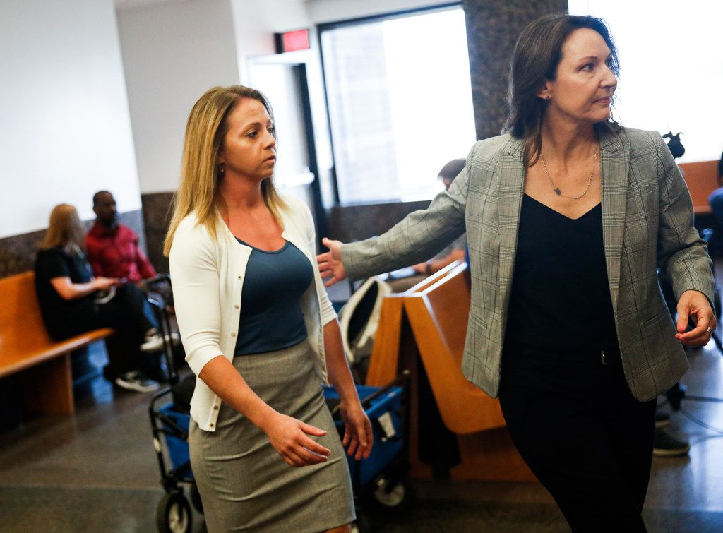 Former Dallas police Officer Amber Guyger (left) enters the 204th District Court in the Frank Crowley Courts Building for a pretrial hearing on Monday, Aug. 19, 2019. in Dallas. Guyger is charged with murder in the Sept. 6, 2018, shooting death of Botham Jean in his own apartment.