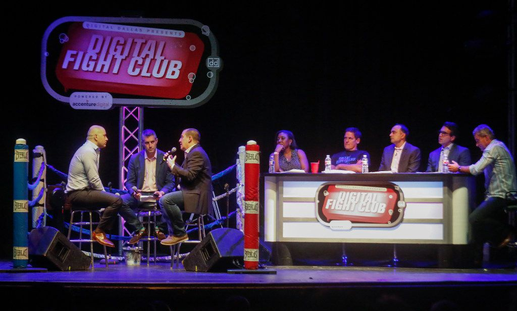 """The first fight at the Digital Fight Club, held at the Granada Theater in Dallas, Texas Wednesday August 23, 2017.  From left, Mark Haidar, CEOof Vini,  Micheal Pratt, managing director of Accenture, was the emcee, Mike Courtney - CEO, Aperio  """"fight""""  about Driverless Cars. Listening at right are the fight referees from left, Arnessa Garrett, assistant business editor of The Dallas Morning News, Mark Cuban, CEO of Mark Cuban Companies, Gurmeet Singh the CDO of 7-Eleven, Mo Katibeh, CMO of AT&T Business and Head Referee Andrew Hopkins, Managing Director of Accenture. (Ron Baselice/The Dallas Morning News)"""