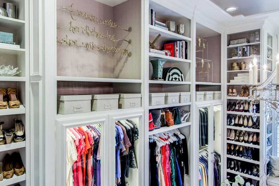 """""""A woman carries the clothes, but the shoes carry the woman,"""" was a custom piece designed for the large closet by EJ Interiors."""