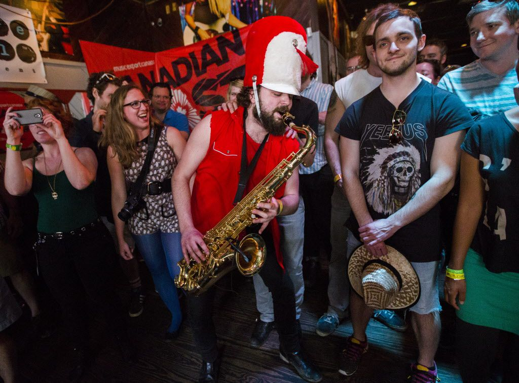Saxophone player Christan Maslyk plays in the crowd during a performance by his band, Wet Secrets, at the bar Friends on Thursday.