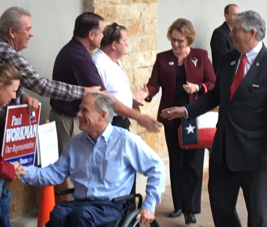 Gov. Greg Abbott greets supporters after voting early at a Randall's supermarket in far south Austin on Feb. 20, 2018. Rep. Paul Workman of Austin (right) is one of the Republicans Abbott has endorsed in contested primaries.