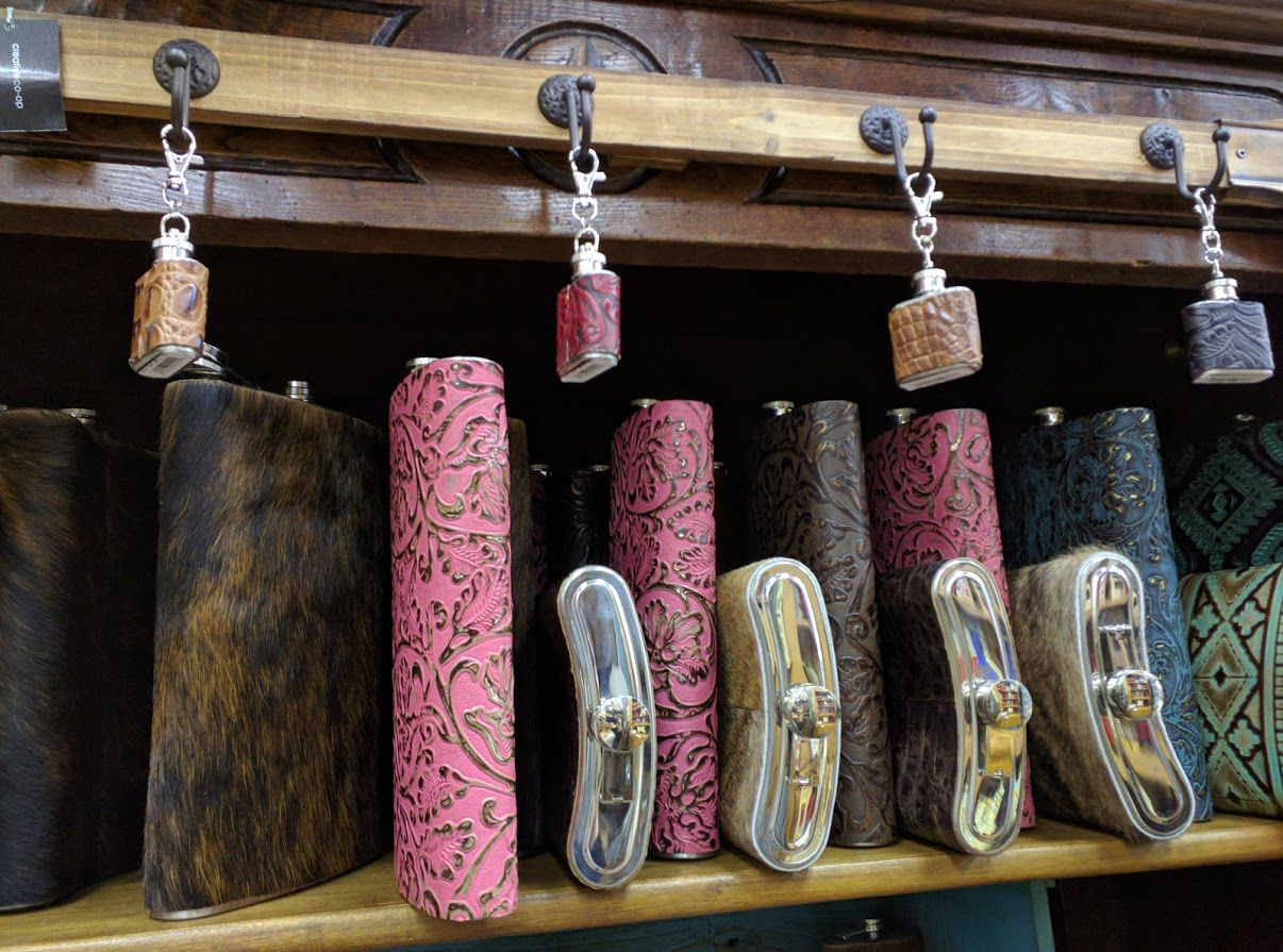 Need a huge flask? How about a tiny one? Now in cowhide.