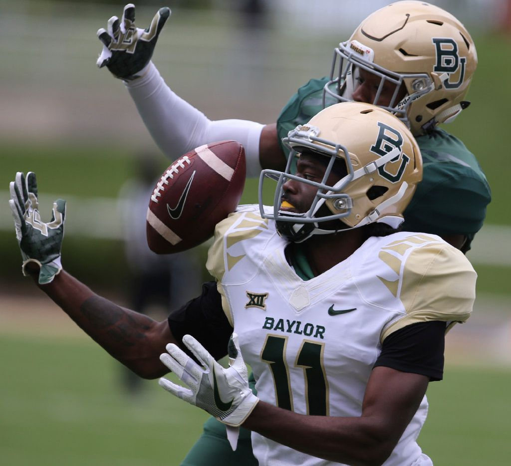 Baylor wide receiver Pooh Stricklin (11) attempts a catch as safety Jourdan Blake (23) defends during the first half of the NCAA college football team's Green and Gold spring game, Saturday, April 22, 2017, in Waco, Texas. (Rod Aydelotte/Waco Tribune Herald via AP)