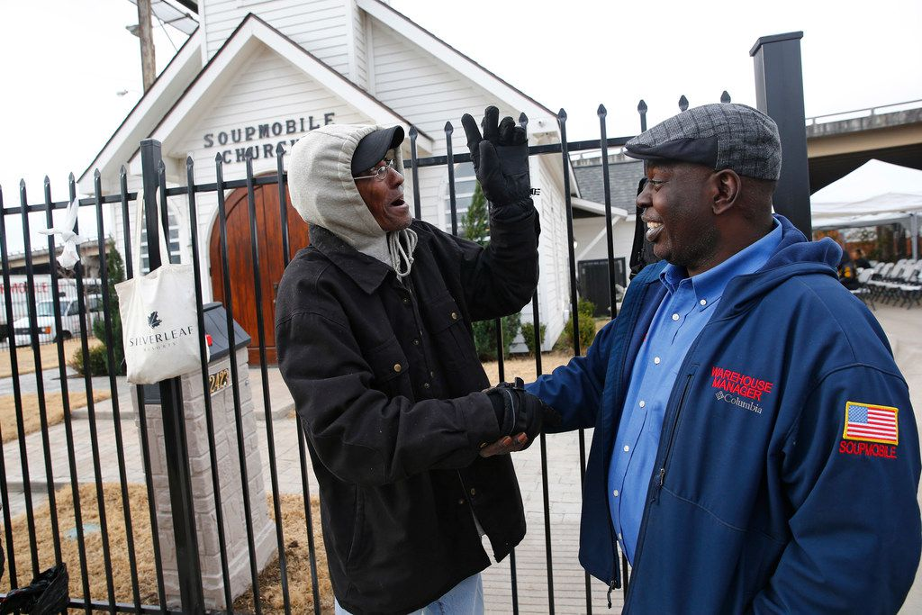 Willie Pearson (left) was greeted by Harvor Davis, church manager, as homeless people lined up at the gates before the service at the SoupMobile Church for the homeless in Dallas on Feb. 4, 2018.