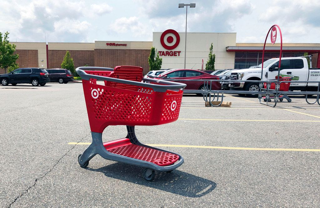 In this June 2019 file photo, a shopping cart sits in the parking lot of a Target store in Marlborough, Mass.