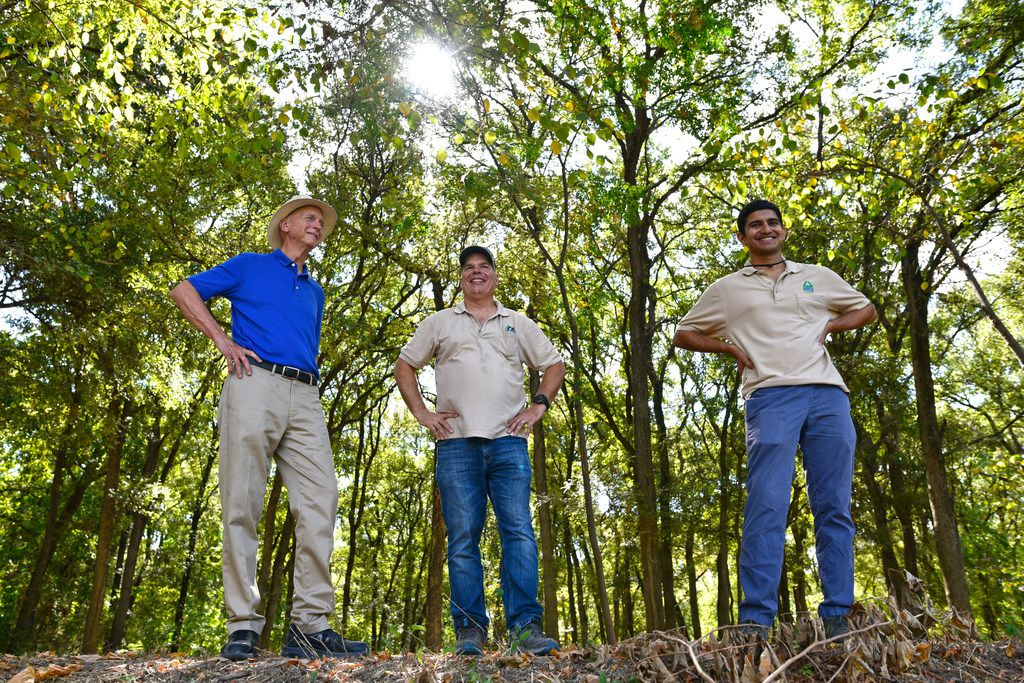 Environmentalist and Container Store co-founder Garrett Boone (from left), with Richard Buckley, executive director of Groundwork Dallas, and Aaryaman Singhal, chief operating officer of Groundwork Dallas, during a tour of the trails near the Elm Fork of the Trinity River.