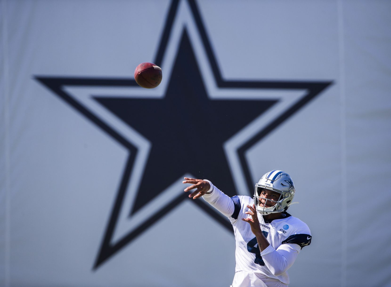Dallas Cowboys quarterback Dak Prescott (4) throws a pass during an afternoon practice at training camp in Oxnard, Calif., on Monday, July 29, 2019.
