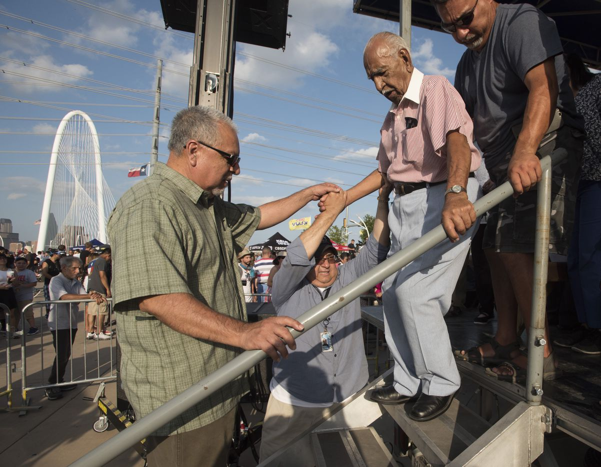 Felix H. Lozada Sr. center, is helped down the stairs by his sons Joe Lozada, left,  and Raul Lozada after the dedication of the Felix H. Lozada Sr. Gateway during the Red, White, and Boom on the Bridge event in Dallas, July 3, 2016.