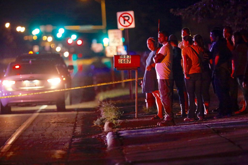 A crowd gathers where a police officer shot a man in a car Wednesday in Falcon Heights, Minn.