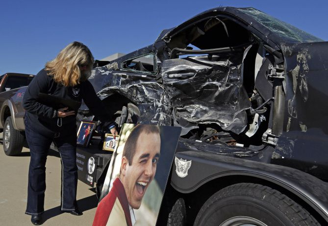 Kae Pennywell displayed pictures of her son during a joint DWI news conference Wednesday with Dallas and Tarrant County officials at police headquarters in Grand Prairie. Aaron Pennywell was killed by a drunken driver on June 25, 2011.