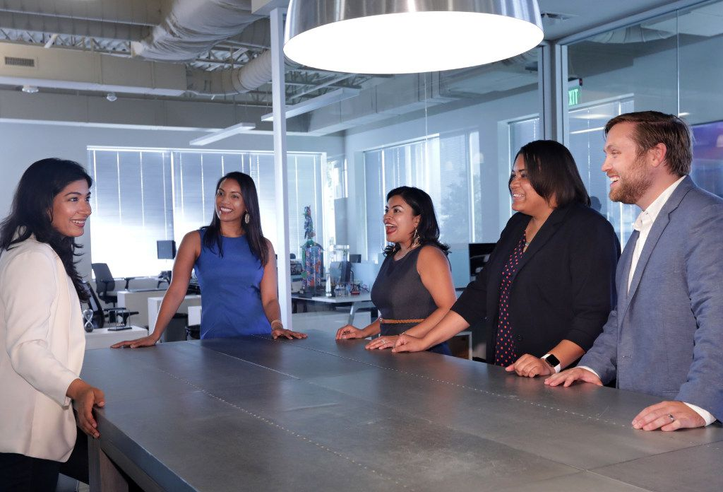 Maddy Kulkarni, left, Shahnaj Ahmad, Preeti Gupta, Tionna Cunningham, and Dustin Joost hold a meeting for the Dallas Heroes Project at an office in Plano, TX, on June 16, 2017. (Jason Janik/Special Contributor)