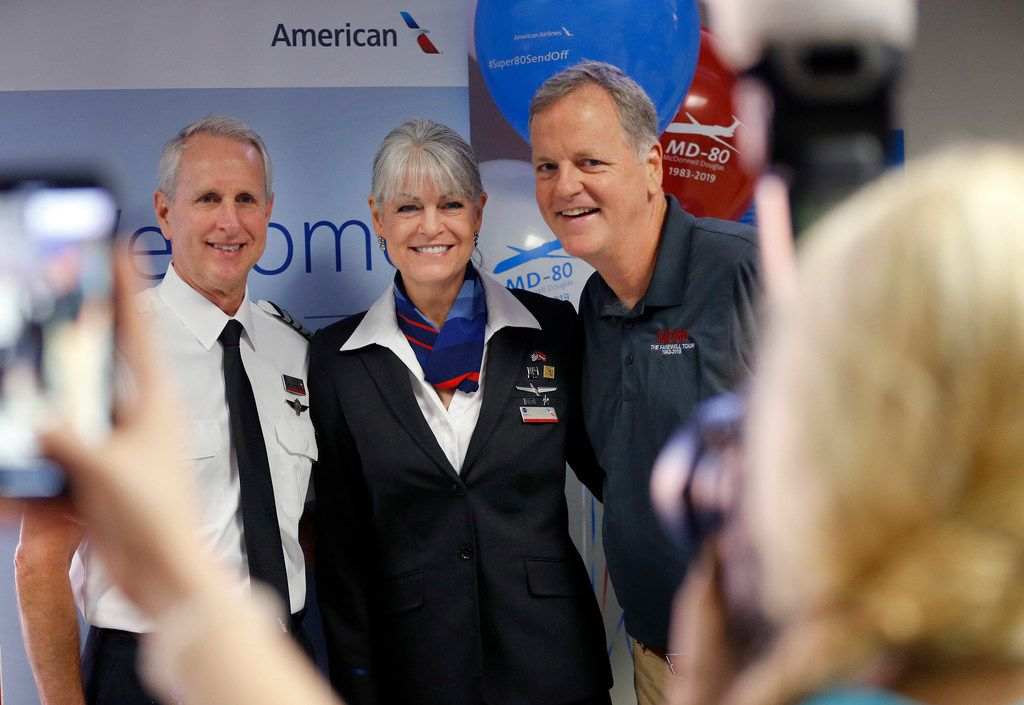 American Airlines CEO Doug Parker (right) joined pilot Greg Kunasek and flight attendant Patti Strait for a photo before they boarded the final American MD-80 revenue flight on Sept. 4.