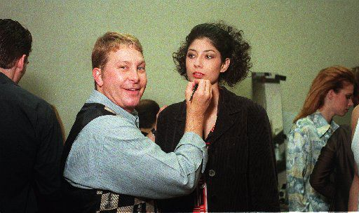 "Paul Neinast with model ""Isabell,"" backstage at the Gianni  Versace show at the Starck Club in Dallas in the 1990s"