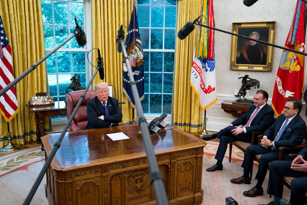 President Donald Trump after speaking on the phone with Mexican President Enrique Pena Nieto after the announcement that the U.S. and Mexico have reached agreement to revise the North American Free Trade Agreement, in the Oval Office of the White House, on Aug. 27, 2018. Also pictured (from right) is Mexico's Economy Minster Ildefonso Guajardo and Foreign Minister Luis Videgaray.
