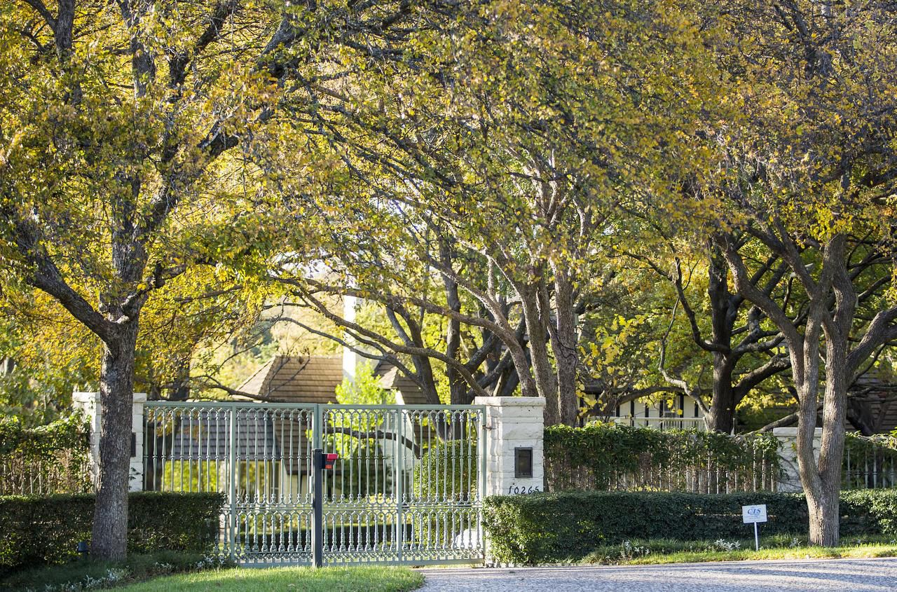 The residence of Dennis Topletz is behind the gates on Inwood Road in Preston Hollow. The Dallas Central Appraisal District lists 137 of 190 Topletz-controlled properties in poor, very poor or unsound condition.