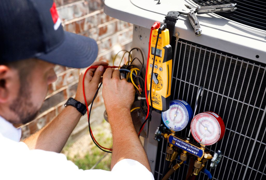 Technician Brandon Cronkhite from Berkeys Air Conditioning added refrigerant last summer to an outdoor condensing unit at a Southlake home.