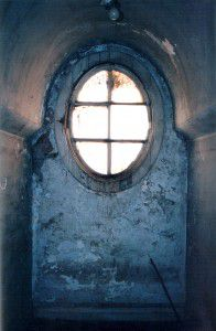 A dingy film covers the ornate oval windows of the 19th floor ballroom which has been vacant for decades. (DMN files)