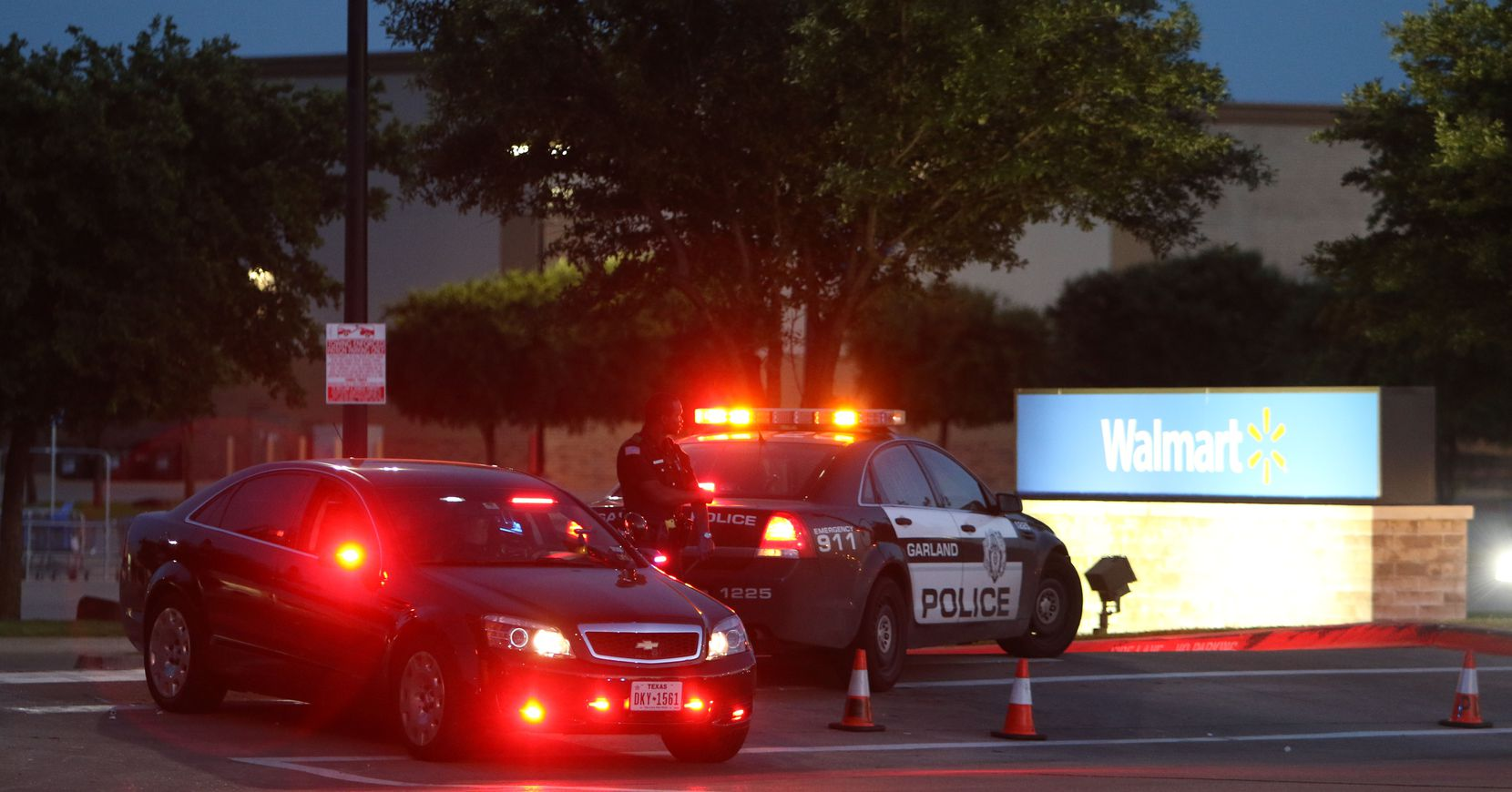 Police outside of an evacuated Walmart on North Garland secure a perimeter after a shooting during the American Freedom Defense Initiative program at the Curtis Culwell Center on Sunday, May 3 2015 in Garland, Texas. (Gregory Castillo/The Dallas Morning News)