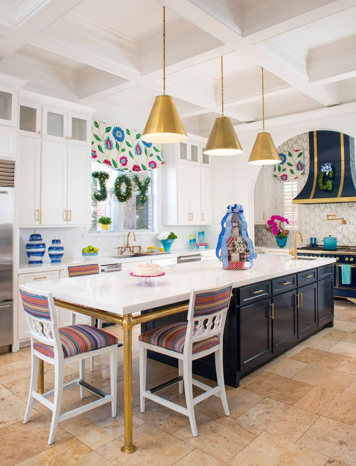 The kitchen at designer Shay Geyer's home has merry greenery and an advent calendar.