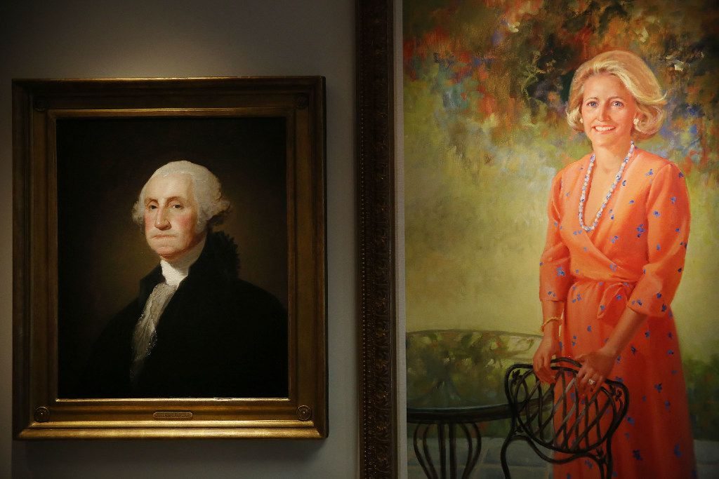"(From left) Portrait of George Washington, referred to as the ""Athenaeum portrait"" by artist Gilbert Stuart, and a portrait of Margot Perot, who is Ross Perot's wife, are among the personal artifacts of Ross Perot Sr. at The Perot Group headquarters in Plano, Texas Friday October 14, 2016. The Perot Group is in the process of moving its headquarters. (Andy Jacobsohn/The Dallas Morning News)"