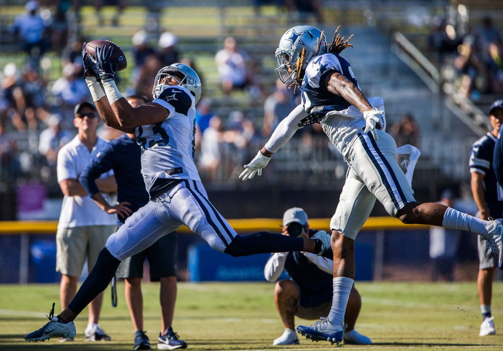 Cowboys wide receiver Jalen Guyton (83) makes a catch in the end zone over defensive back Treston Decoud (34) during an afternoon practice at training camp in Oxnard, Calif., on Friday, Aug. 2, 2019. (Ashley Landis/The Dallas Morning News)