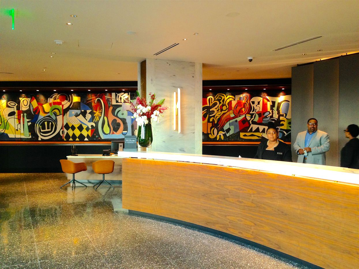 The Statler Hotel front desk showcases a restored midcentury mural by New York artist Jack Lubin.