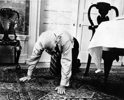 """Dallas billionaire H. L. Hunt, 83, demonstrates his yoga exercise called """"creeping,"""" which he does for two or three minutes several times a day. He also has yoga lessons twice a week and maintains a strict regimen of healthy foods."""