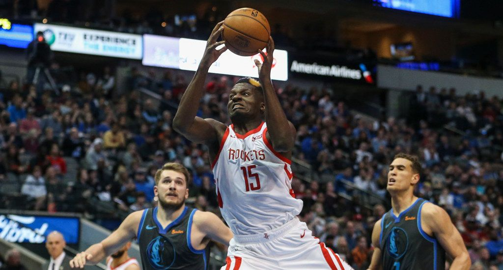 Houston Rockets center Clint Capela (15) goes up for a shot past Dallas Mavericks forward Luka Doncic (77) and forward Dwight Powell (7)during the second half a matchup between the Dallas Mavericks and the Houston Rockets on Sunday, March 10, 2019 at the American Airlines Center in Dallas. (Ryan Michalesko/The Dallas Morning News)