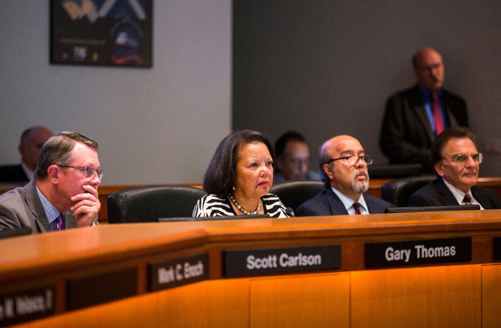 The board of the Dallas Area Rapid Transit, including Richard Carrizales (second from right), votes on a rail corridor on Tuesday, Oct. 25, 2016 at DART headquarters in Dallas.