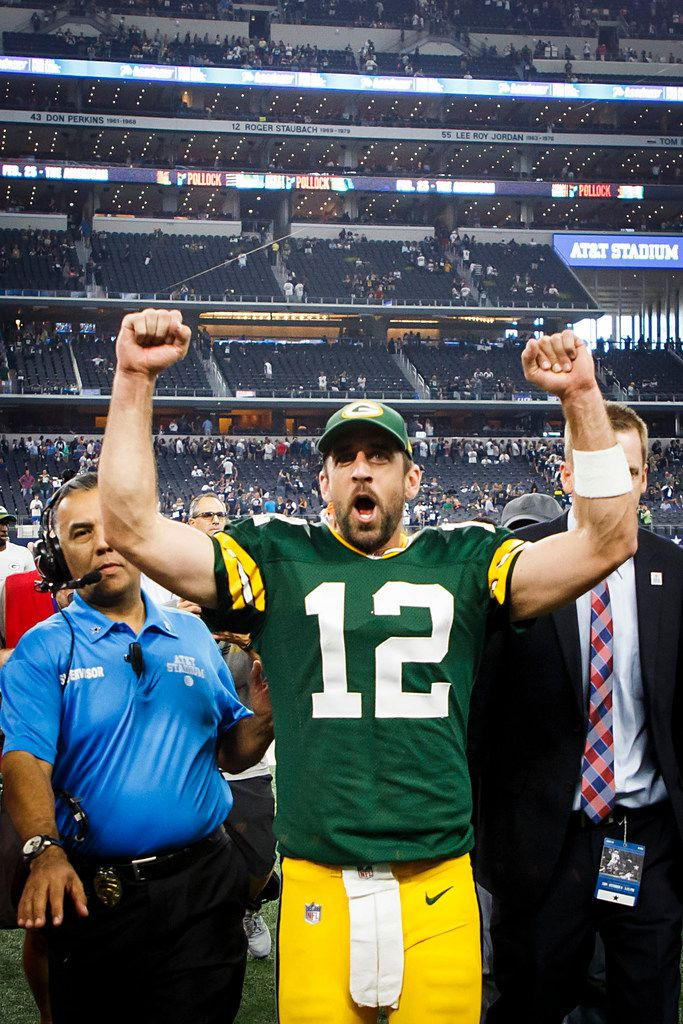 Green Bay Packers quarterback Aaron Rodgers celebrates as he leaves the field following the Packers' 35-31 victory over the Dallas Cowboys in an NFL football game at AT&T Stadium on Sunday, Oct. 8, 2017, in Arlington. (Smiley N. Pool/The Dallas Morning News)