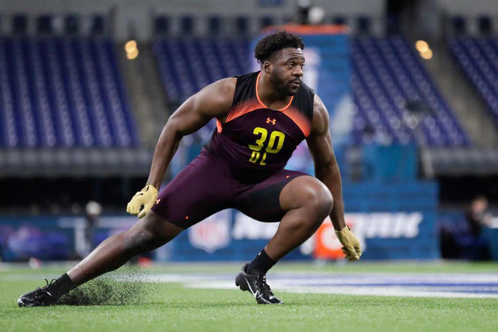 TCU defensive lineman L.J. Collier runs a drill at the NFL football scouting combine in Indianapolis, Sunday, March 3, 2019. (AP Photo/Michael Conroy) ORG XMIT: INMC10