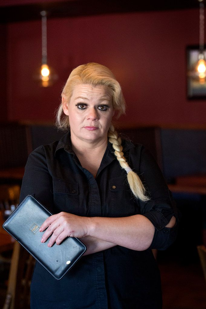 """Christal Scott, a 43-year-old single mother and waitress, posed for a portrait in December at Kay's Restaurant and Bar, where she works in Dallas.  After getting into a dispute over payments and having her car repossessed by 1and2 Automotive, Scott took the used car dealer to small claims court and was awarded $2,000.  """"I still feel like I lost,"""" she said."""